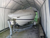 covered boat in carport