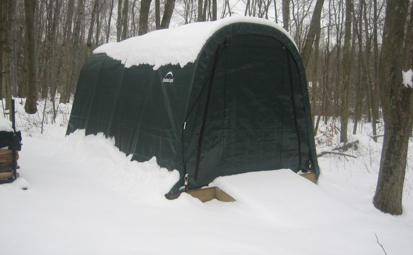 Portable garage covered in snow