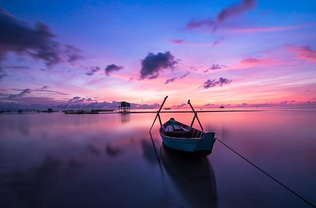 boat under sunrise